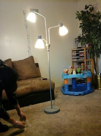 gray and white 3-arm floor lamp