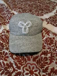 gray and white fitted cap Surrey, V3W