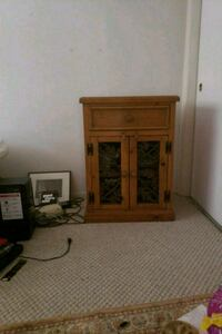brown oak and wriught iron decframed glass cabinet Los Angeles, 91364