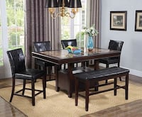 rectangular brown wooden table with four chairs dining set Houston, 77092