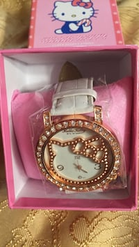 round gold-colored analog watch with link bracelet Mississauga, L5R 1N8