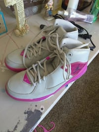 pair of white-and-pink Nike basketball shoes El Paso, 79924