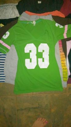 green and white 33 v neck jersey shirt
