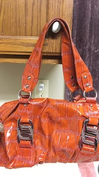 orange and black shoulder bag