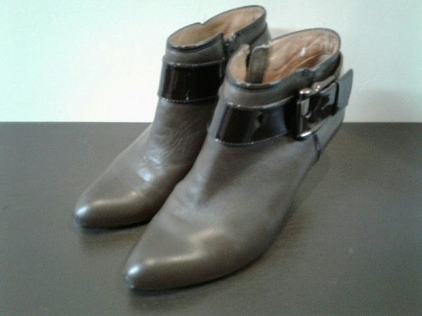 women's pair of black leather heeled boots