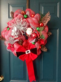 red ribbon wreath with Santa Claus