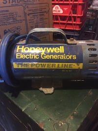 blue and yellow Honeywell Electric generator