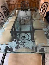 Etched glass dining table, 98L x 48w. Wood buffet, gold gilded mirror,