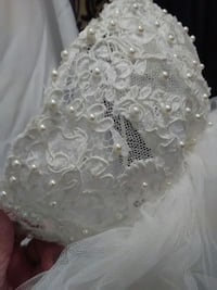 Three tiered veil appliques trimmed in white pearl