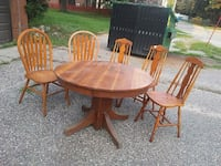 round brown wooden pedestal table with four chairs dining set Baraboo, 53913