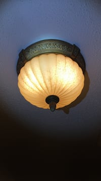 Brass-colored and beige dome lamp