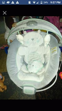 baby's white and gray bouncer
