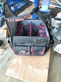black and red utility organizer bag