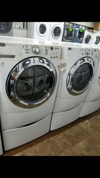 two white and silver front load washer and dryer