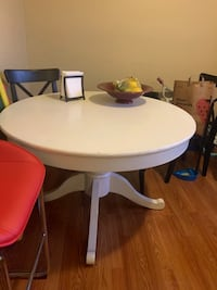White Pedestal Style Dining Table