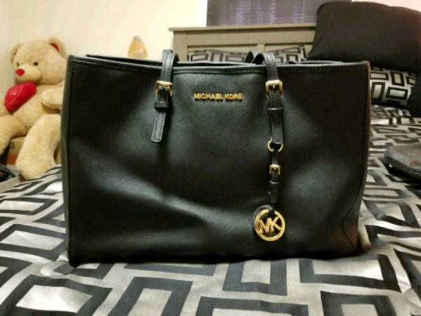 4e96eab9cb1b Used black Michael Kors leather tote bag for sale in Paterson - letgo