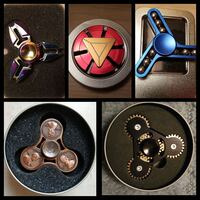 four assorted color fidget spinners 536 km