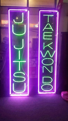 Jujitsu and tkd neon sign. Good condition. 350each