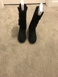 Ugg pair of black leather boots
