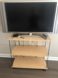 gray flat screen TV with white wooden TV stand Arlington, 22201