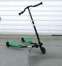 green and black kick trike scooter
