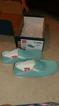 pair of teal-and-white Tony Lama shoes