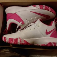 Pink and white nike Plains, 18705