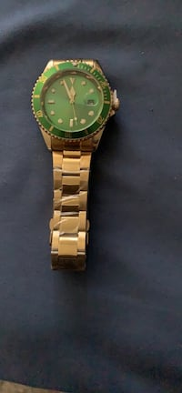 round gold analog watch with gold link bracelet Las Vegas, 89146