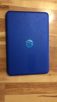 Blue and black hp laptop 550 km