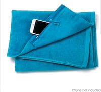 Towel with zippered phone pocket.  New Edmonton, T6M 2G7