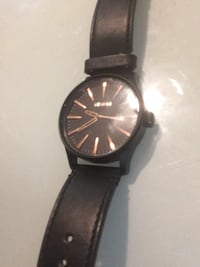 Nixon rose gold and black leather strap Coquitlam, V3B 6W6