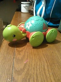 green, yellow, and red plastic toy turtle Tulsa, 74120