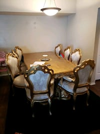 gold and white Victorian style living and dining s Saint Petersburg