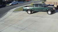 green and gray extended cab pickup truck Bakersfield, 93314