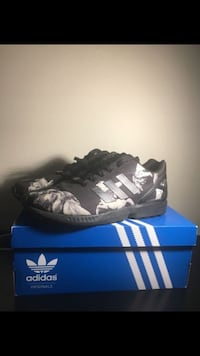 unpaired gray and black adidas cleat with box Alexandria, 22312