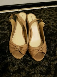 pair of brown leather flat shoes Brampton
