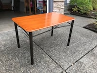 rectangular brown wooden table with black metal base Abbotsford, V3G 2Y1