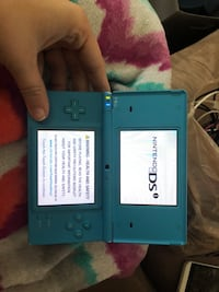 gray Nintendo DS with game cartridge 526 mi