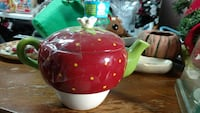 red and white ceramic teapot