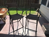 Two black metal frame bar stools been outdoors Fort Worth, 76179