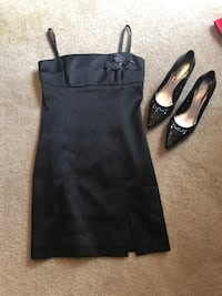 women's black spaghetti strap dress and pair of pumps