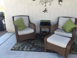 Patio chairs, footstool, and table