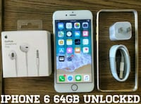 silver iPhone 6 with charger and EarPods Arlington
