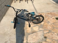 black and blue BMX bike