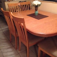 round brown wooden table with four chairs dining set Vancouver, V5R 1J6