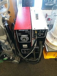 black, white, and red Snap-on welding machine 42 mi