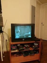 black flat screen TV with brown wooden TV hutch Arlington, 22201