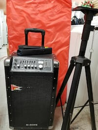 black M-Zone speaker and tripod stand
