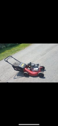 Red and black push mower Fort Washington