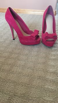 Pair of red peep-toe platform stilettos Calgary
